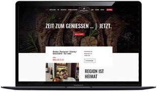 Website genussfabrik-trier.de sichtbar in Laptopmonitor