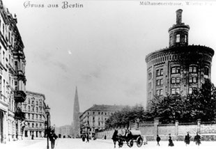 A postcard from around 1910 showing the 1877 water tower before its expansion