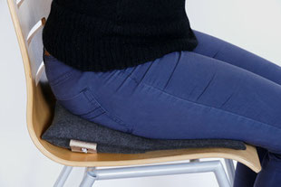 Individuell eingestellter Sitzkeil beim grau/blauem Flowmo Pad