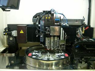 研磨定盤の形状修正修正を行う装置