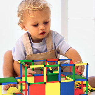 miniQUADRO toddler playing with DUOMOBIL