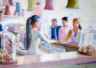 Bild eines Cafés mit Kunden, die sich gerade einen Kaffee kaufen.
