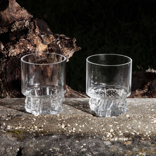 The Cerne glasses have their shape by blowing glass into hollow wooden tree trunk mould