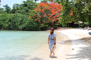 Woman walking along white sand beach in hidden lagoon - Day Trip to Negril