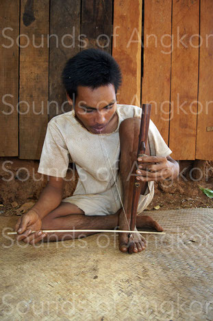 C. Player of buccal resonator fiddle. Kreung. Cambodia.