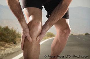 Jogger hält sich das Knie - © Focus Pocus LTD - Fotolia.com