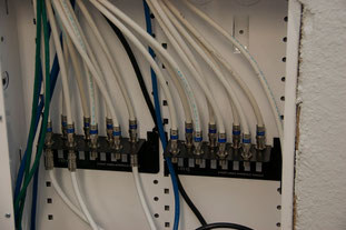 This is the coax 'patch panel'. Each of the wires on the top half of the panel leads to a coax outlet somewhere in the house, which is reachable simply by connecting to the bottom side of the panel.