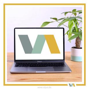 Logodesign: unser Logo von VAJUS Virtuelle Assistenz auf einem Laptop