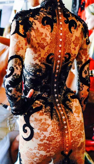 Tatooed body in Calais' lace and black velvet. 15th Anniversary Couture show backstage - Palais Brongniart, Paris 2015