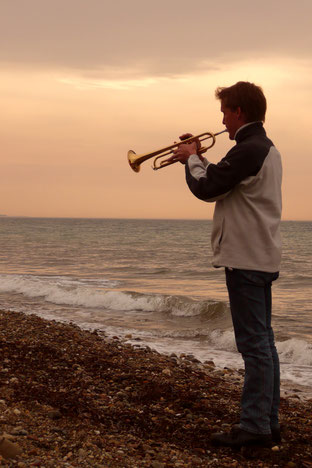 "Playing the Last Post at ""ANZAC Cove"" in 2008. Photograph copyright by Geri Wijnen."