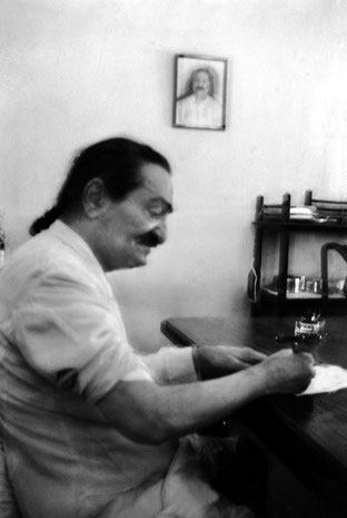 "18th March 1955 - Satara, India ; Meher Baba signing copies of the frontal pages of ""God Speaks"" book. Photo taken by Mani Irani."