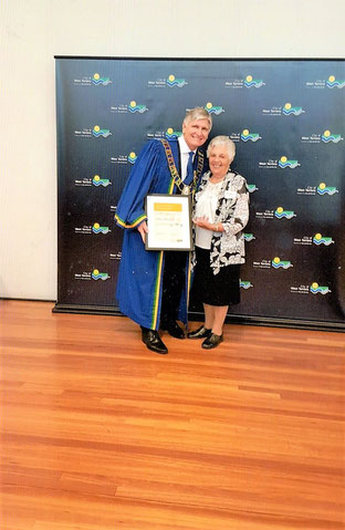 From left, Mayor Michael Coxon with Mary Mangos.