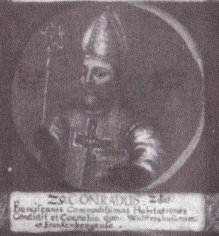 """Konrad als 29. Bischof von Hildesheim auf einem Gemälde mit Medaillondarstellungen aller Hildesheimer Bischöfe bis zum Ende des 18. Jahrhunderts; lateinische Inschrift: """"Er gründete eine gut ausgestattete Niederlassung der Franziskaner sowie die beiden Kl"""