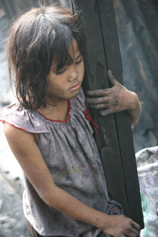 A child takes a break from a charcoal-making job in Manila, Philippines (Photos courtesy of John Francis Lagman)