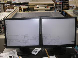 コンピュータで作図された型紙(奥は裁断機)
