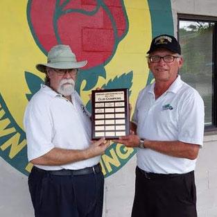 Photo of men's champions holding plaque.