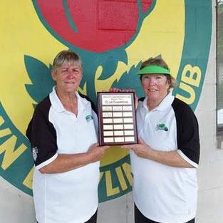 Photo of women's pairs winners holding plaque.