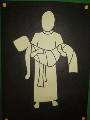 Jesus wird vom Kreuz genommen und ins Grab gelegt.