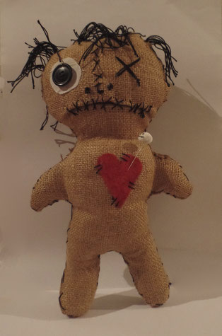 "34 cm (13.5"") stuffed doll, with a customised skull pin."