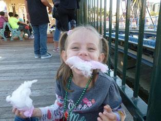 Naomi eating Cotton Candy at Disneyland
