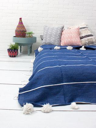 Tagesdecken aus Baumwolle oder Wolle mit Bommeln