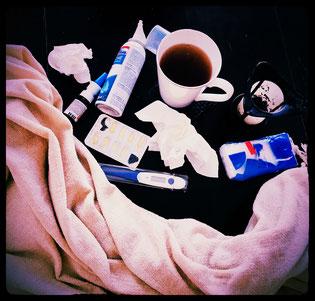 Man-flu, nasal spray, tea, tissues & medicine
