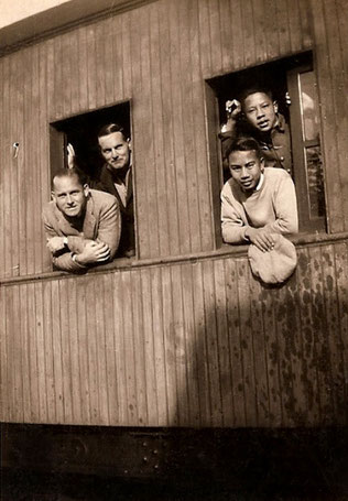 Train travelling in China - Herbert is on the left-rear  with unknown man.