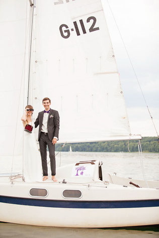 Newly weds on a boat after wedding in berlin