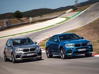 Starkes Duo: BMWs neue Hochleistungsmodelle X5 M (l) und X6 M (r) kommen im März nächsten Jahres auf den Markt. Foto: BMW