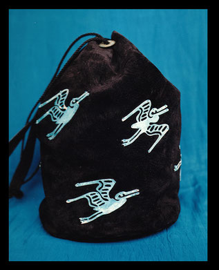 Black suede bag embellished with stylized patina copper birds designed by Vicki Israel
