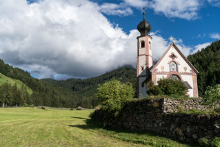 A beautiful church in the middle of a freshly cut meadow