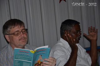Olivier reading one the gilft for the children of Thambi Illam - December 2012
