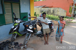 Saravana near the bike and Asha bringing water for the cooker - 2012