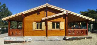 Blockbohlenferienhaus mit wenig Holz -  Foto Pixabay