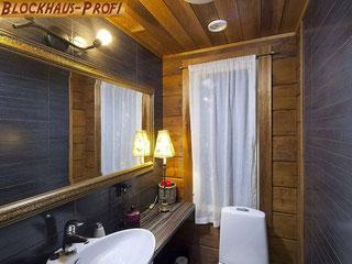 Exklusives Gästebad im Blockhaus - Wohnhaus Schwerin - Der Baustoff Holz kommt in einem neuartigen Massivholzhaus fantastisch zur Geltung - Schöner wohnen in einem ökologischen Blockhaus
