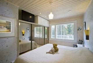 Schlafzimmer im Blockhaus Greifswald - Finnische Blockhäuser nach Ihren Wünschen und Vorstellungen  - Transparente, diffusionsoffene, schmutzabweisende Holzlasuren