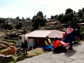 © Winifred. The women in Taquile Island, Puno providing support and friendship to one another.