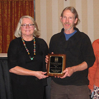 Michael Nerrie of Distant Hill Gardens is show here accepting the 2015 award from Linda Brownson, the president of the NHACD.