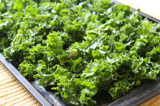kale pieces before they are baked and turn into delicious kale chips