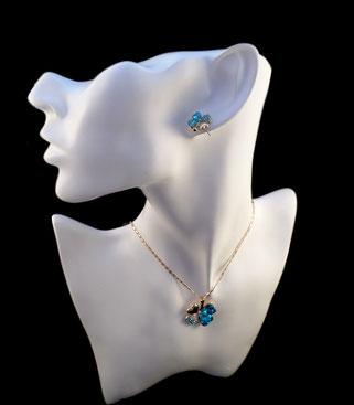 parure trèfle à quatre feuilles bleue turquoise collier et boucles d'oreilles