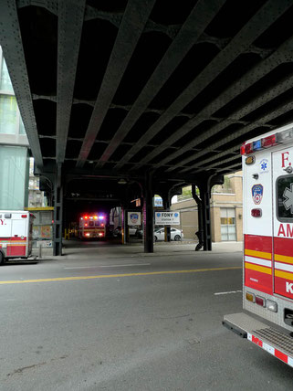 Ambulance car under the bridge