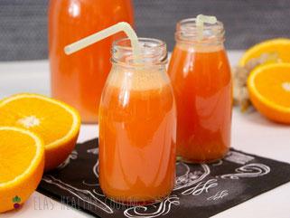 Ingwer-Melonen-Shot, dekoriert mit Orangen und Ingwer