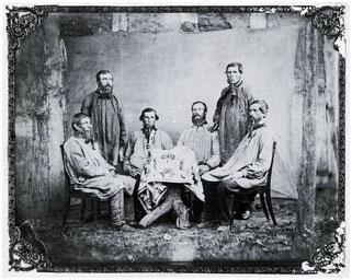 Steiger J. Stauß mit Bergleuten der Grube Ludwig, um 1875