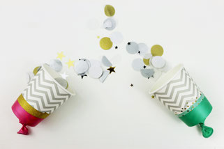 Bild: DIY Deko für die Party oder Hochzeit selber machen - finde kreative Ideen für schöne Dekoration zum selber basteln auf www.partystories.de // DIY Konfetti Kanonen aus Pappbecher und Luftballon basteln Anleitung