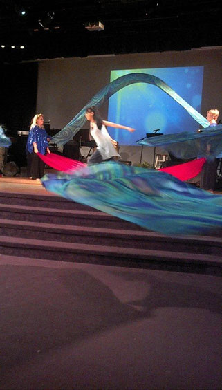Living Water Silks being used in a dance, as flags and as billows.