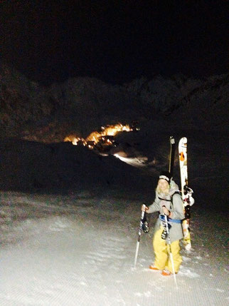 climbing 1641 Ft from St Christoph to the top of Galzig to ski a freshly piested run in the light of a full moon