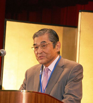 主催者挨拶の神谷光信理事長