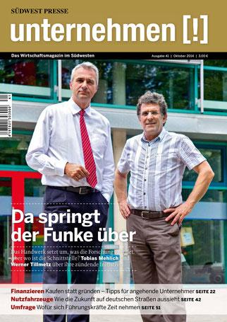Unternehmen[!]- Magazin mit zwei Männern