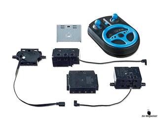 Im Paket Playmobil 6914 ist enthalten ein Sendemodul, Empfängermodul, Handsender, Lenkeinheit mit Abdeckung.