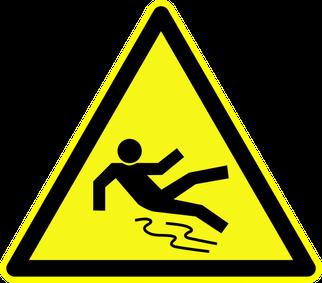 """Warnschild """"Warnung vor Rutschgefahr"""" als Symbolbild für das Schaum-Seminar"""